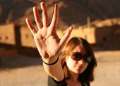 stock photo of goodbye  - woman waving her hand to say goodbye - JPG