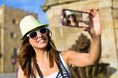Female Tourist Taking Selfie Photo With Smartphone