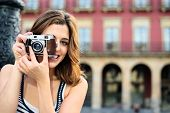 Female Tourist Taking Photos In Spain