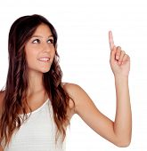 Casual girl indicating something with her finger isolated on a white background
