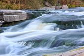Waterfall among stones in river