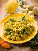 gnocchi with ricotta carrot and lemon peel, vegetarian food