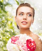 beauty, holidays, people and jewelry - woman with diamond earrings, ring and flower