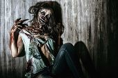 Furious bloody zombie girl. Horror. Halloween.