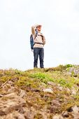 adventure, travel, tourism, hike and people concept - smiling man with backpack outdoors