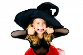 Pretty little girl in a witch costume making faces. Halloween. Isolated over white.