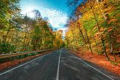 Autumn scenic view of rocky mountains and road