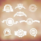 white badges and ribbons on vintage background