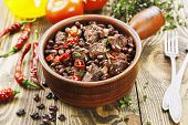 picture of stew  - Meat stew with red beans and chili pepper on the table - JPG