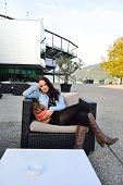 Young woman enjoying on a terrace