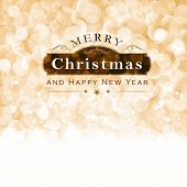 Christmas background with light effects and blurry light dots in shades of beige, golden and white. Centered is a label with the lettering Merry Christmas and Happy New Year.