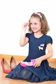 foto of little girls photo-models  - Cute little girl posing while making up - JPG