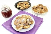 Poffertjes With Powdered Sugar And Fruit Jelly