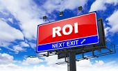 Roi Inscription on Red Billboard.