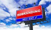 Rebranding Inscription on Red Billboard.