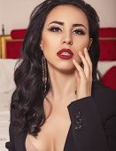 Portrait Of Beautiful Girl With Dark Hair And Red Lipstick