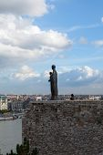 BUDAPEST, HUNGARY - OCT 21 2014 : A statue gazes across the Danube from the Castle walls.