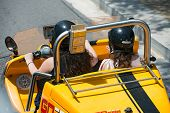 Barcelona, Spain - June 18, 2014: Tourists Are Driving Small Car Of Gocar Tours Through Barcelona St
