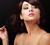 Beautiful Flirting Woman Looking. Closeup Portrait On Black