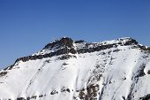 foto of avalanche  - Snowy rocks with traces of avalanches - JPG