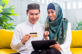 picture of muslim man  - Asian Muslim man and woman shopping online paying with credit card on tablet PC - JPG