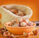 foto of cobnuts  - hazelnuts in bowl and on a table - JPG