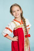 foto of scythe  - Blond girl with a scythe in the traditional Russian folk costume - JPG