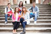 pic of staircases  - Group of smiling students sitting on a staircase - JPG