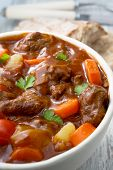 foto of stew  - Beef Stew with carrots potatoes and bread - JPG