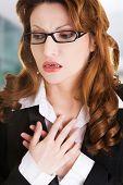 stock photo of breast-stroke  - Young businesswoman having heart disease - JPG
