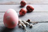 image of pussy-willows  - Bird colorful egg in nest and pussy willow branches on wooden background - JPG