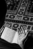 picture of quran  - Muslim Man Is Reading The Holy Quran - JPG