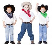 stock photo of texans  - Three boys dressed up as cowboys in studio - JPG