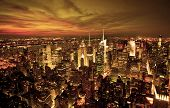 stock photo of roof-light  - New York sunset skyline taken from the Empire State Building with gold filter - JPG