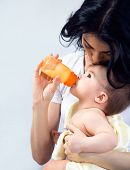 picture of breastfeeding  - Happy mother breastfeeding her baby - JPG