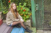 picture of country girl  - Pretty young girl sitting on the steps near the country house - JPG