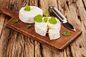 pic of wood pieces  - French Camembert pieces served on wood - JPG