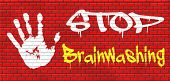 picture of brainwashing  - stop brainwashing no indoctrination or manipulation free rational and creative thinking no dogmas or doctrine from religion have you own opinion graffiti on red brick wall - JPG