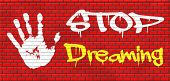 stock photo of daydreaming  - stop dreaming face hard reality and check truth no daydreaming being down to earth graffiti on red brick wall - JPG