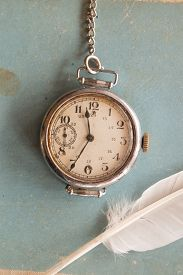 stock photo of politeness  - Old watches on a blue background and feather vintage - JPG