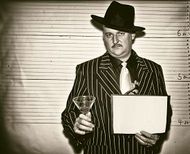 picture of lineup  - Man dressed as a 1920s ganster in police line up - JPG