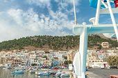 foto of greek-island  - Front view of Pothia city bay on Greek Dodecanese Kalymnos island - JPG
