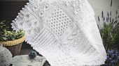 stock photo of knitting  - Cable Knit Afghan Crochet Baby Blanket in White on Sofa with Lavender - JPG