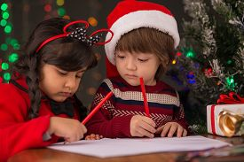 pic of letters to santa claus  - Two little children writing letters for Santa Claus - JPG