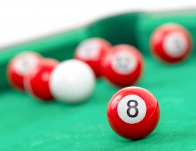 stock photo of snooker  - Snooker balls on a green snooker table - JPG