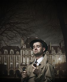 picture of snob  - Funny vintage investigator in trench coat holding a pipe - JPG
