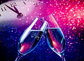 Champagne Flutes With Golden Bubbles On Blue And Purple Violet Light Bokeh Background poster