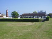 stock photo of crown green bowls  - very english sportcrown bowling on small town green in devon