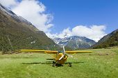 pic of cessna  - Plane on a rough airstrip in the Upper Wilkin River Valley in New Zealand - JPG