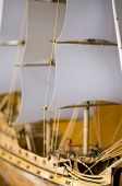 Part of ship with focus on a sail
